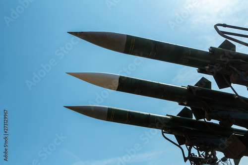 Photo three missiles of an anti-aircraft missile system are aimed at the blue sky