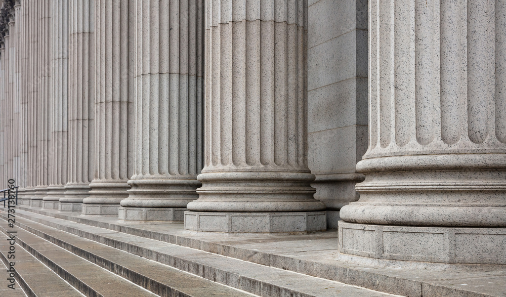 Photo  Stone pillars row and stairs detail. Classical building facade