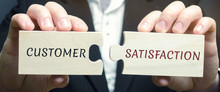 Businessman Collects Wooden Puzzles With The Word Customer Satisfaction ( CSat ). It Is A Measure Of How Products And Services Supplied By A Company Meet Or Surpass Customer Expectation. Marketing