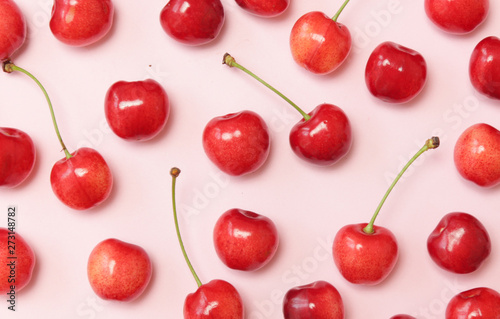 Sweet cherries on pink background, top view - 273148782
