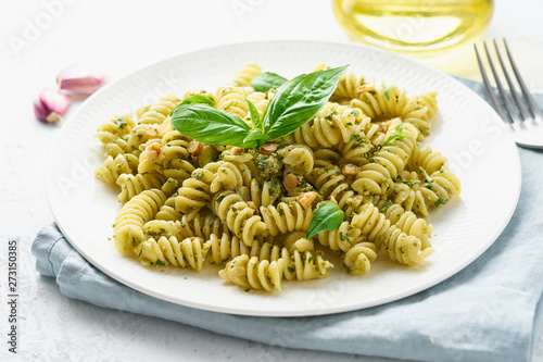 Cuadros en Lienzo fusili pasta with basil pesto and herbs, italian cuisine, gray stone background,