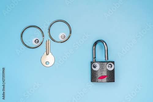 Funny key and lock concept, copy space  Check the security system of