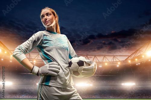 Isolated Female Soccer Goalkeeper on white background. Girl with soccer ball