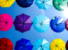 Roof Of A Lot Of Colorful Hanging Umbrella Against Blue Sky
