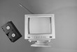 canvas print picture Retro wave, minimalism 80s concept. Retro TV with antenna, video cassette.  Black and white photo. Top view