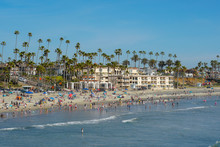 People On The Beach Enjoying Beautiful Spring Day At Oceanside Beach In San Diego, California.