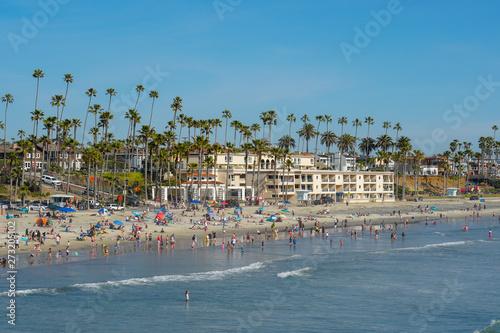 People on the beach enjoying beautiful spring day at Oceanside beach in San Diego, California Wallpaper Mural
