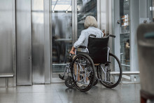 Adult Woman On Disabled Carriage Waiting For Lift