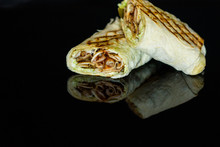 Shawarma With Chicken And Cabbage On A Dark Background.