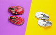 canvas print picture - Two pairs of leather children's sandals on colored background. Top view