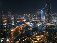 Aerial View Of Illuminated Burj Khalifa Tower And Skyscrapers At Night In Dubai, United Arab Emirates.