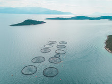 Aerial View Of The Round Fish Farm Pools In The Mediterranean Sea, Greece