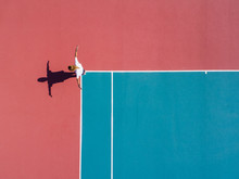 Aerial View Of Person Standing On Tennis Court