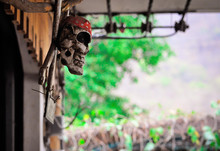 White Skull Handmade In A Red Bandana Hanging Over The Door Of A Resident Of Thailand