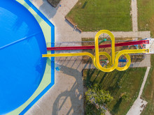 Abstract Aerial View Of Slide And Pool In Abandoned Water Park.
