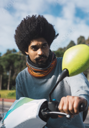 Portrait of black man with afro hair and with vintage style clothes Wallpaper Mural