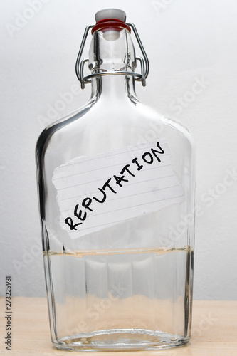 Bottle with a REPUTATION note bonded Canvas Print