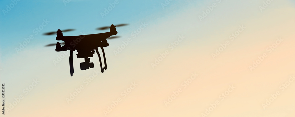Fototapety, obrazy: Quadrocopters silhouette against the background of the sunset ..