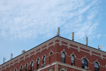 New York Building With Cellular Towers On A Their Rooftop On A Bright Sunny Day