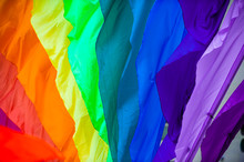 Rainbow Flag Parachute Fabric Fills The Frame For A Colorful Background Of Gay Pride, Inclusiveness, And Tolerance