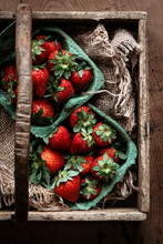 Fresh Ripe Strawberries On A Rustic Background