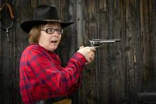 Caucasian Woman Firing Gun Wit...