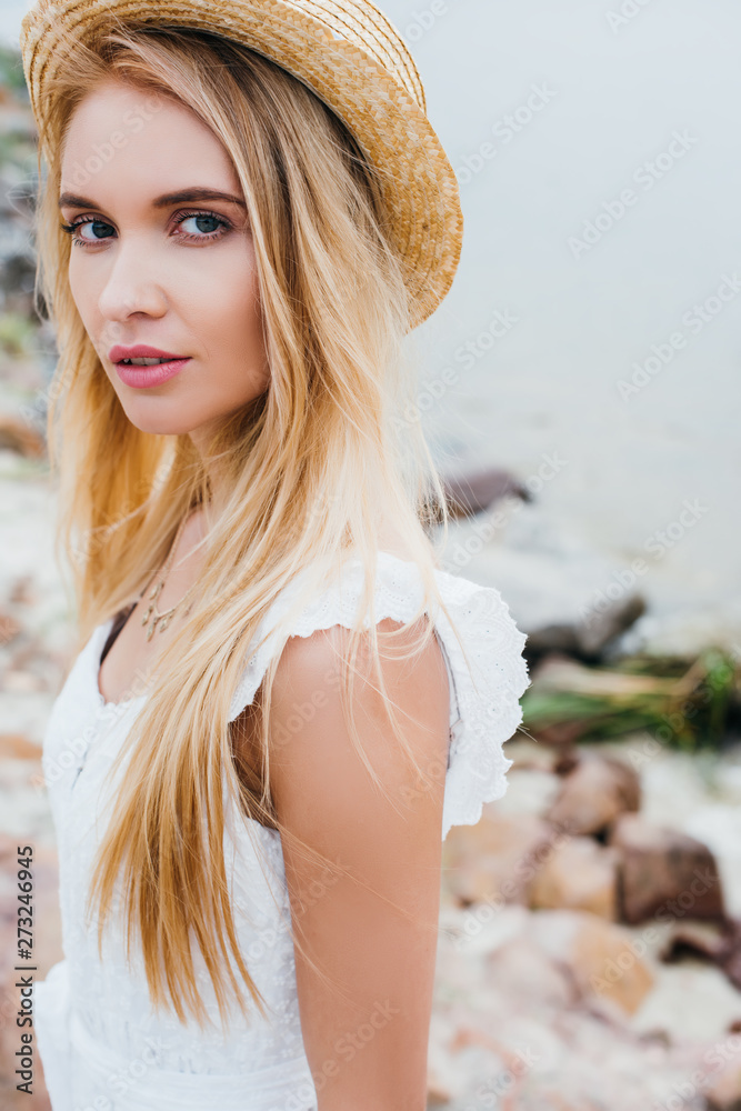 Fototapety, obrazy: attractive blonde woman in straw hat and white dress looking at camera
