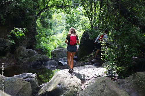 young woman hiking in mountains Wallpaper Mural