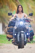 Beautiful Native Woman On A Motorbike