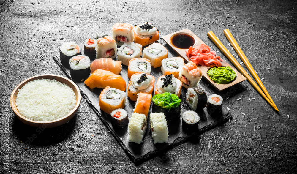Fototapety, obrazy: The range of different types of sushi, rolls and Maki with sauces and chopsticks.