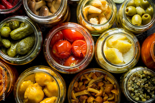 Photo  Preserved vegetables in glass jars.