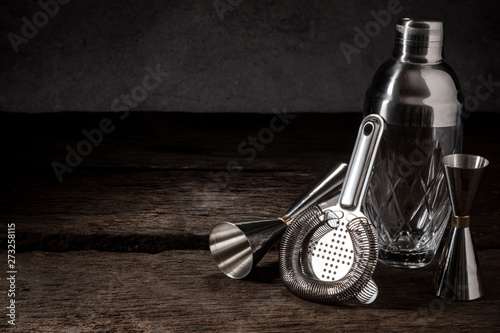 bartender equipment shaker strainer jigger on wood background with copy space Obraz na płótnie
