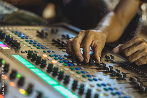 Photo  Technician hand adjust audio  mixer