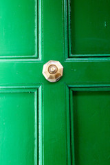 Green wooden door with door handle, Valletta, Malta