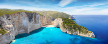 Aerial Panoramic View Of The Famous Shipwreck Beach At Zakynthos Island, Ionian Sea, Greece, With Blue And Turquoise Water