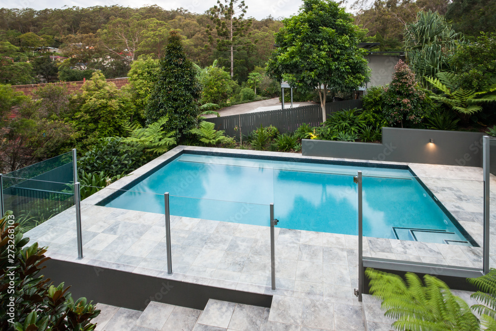Fototapeta Modern swimming pool with a glass fence on the floor