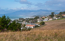 The Picturesque City Of Cambria On The Central California Coast Showing The Native Monterey Pine Trees And The Pacific Ocean