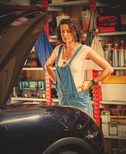 Pretty Woman Mechanic Prepares The Car For The Travel