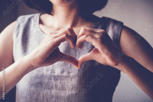 young woman making her hands in heart shape, heart health insurance, social resp Canvas Print