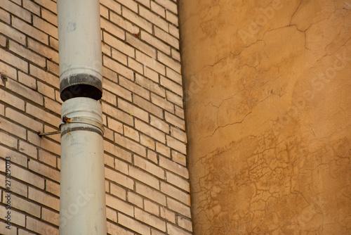 Valokuva  Metal drainpipe on the wall