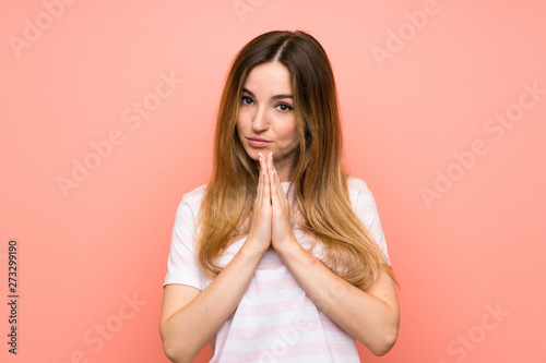Fototapety, obrazy: Young woman over isolated pink wall pleading