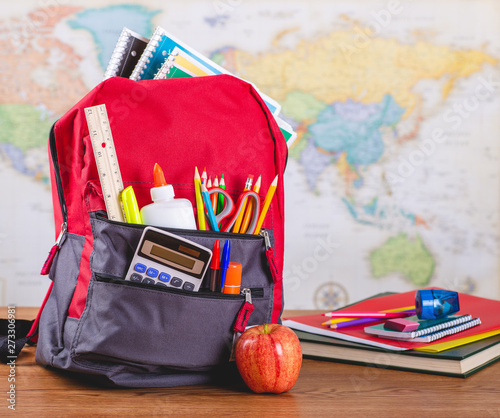 Obraz Backpack With School Supplies on a Desk - fototapety do salonu