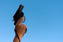A Hand Shotting A Gun For Star...