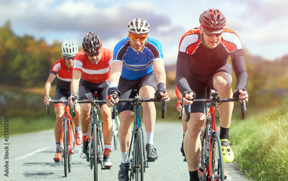 Fototapeta Cyclists out racing along country lanes in the in the United Kingdom