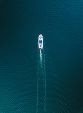 Aerial View Of Luxury Yacht On The Empty Ocean With Copy Space