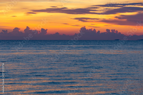 Tropical sea and beach on sunset and twilight sky.