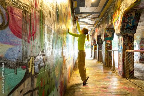 Spray Painting Graffiti in Krog Street Tunnel, Atlanta, Georgia - 273346344