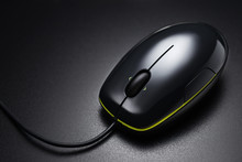 Black Wired Mouse On The Dark Office Desk