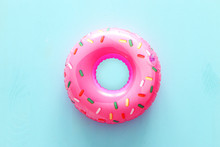 Inflatable Donut Ring Over Blue Wooden Background