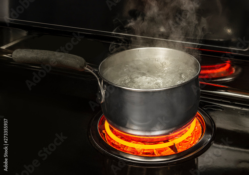 Boiling Pot of Water on Stove With Copy Space Fototapeta